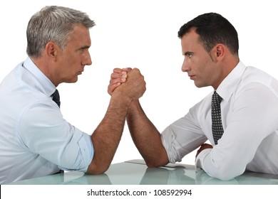 businessmen arm wrestling