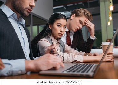 businessmen and asian businesswoman working together with laptop in office
