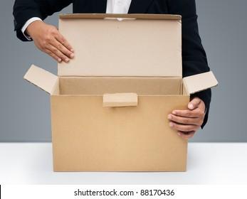Businessmen in black suit Open blank brown paper box