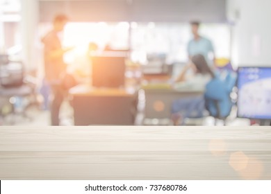 Businessmen blur in the workplace or work space of table in office room with computer or shallow depth of focus of abstract background.