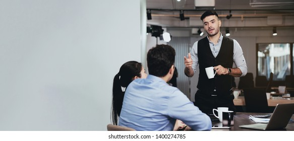 Businessmen are brainstorming in the meeting room. There is a discussion of the strategy of working in accordance with the world economic remnants. In order to achieve the goal And have more profit