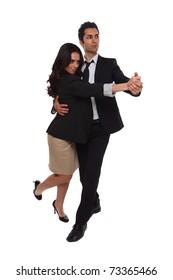 Businessmen and Businesswomen tangoing in the studio