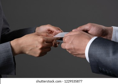 Businessmen and businesswomen who exchange business cards