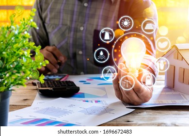 Businessmen calculate electricity bills using a calculator, graph, document. energy resources icon. Earth day. Energy saving concept, Renewable energy and energy sources of the world