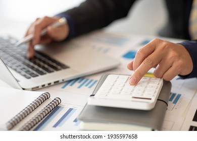 Businessmen are calculating income-expenditure and analyzing real estate investment data, Accounting Financial and tax systems concept. - Shutterstock ID 1935597658
