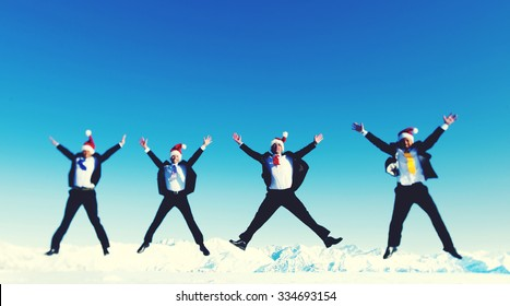 Businessmen Celebrating Christmas on Snow Mountain Concept