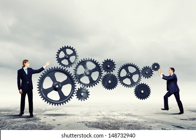 Businessmen with cog wheel elements. Construction concept