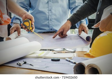 Businessmen and construction engineers, development conferences Buildings and structures