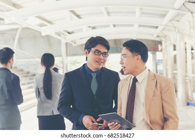 Businessmen contact and discuss business negotiations.how to start building a company,Business friendship and startup  team work concept