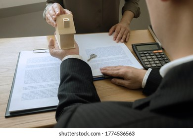 Businessmen contract on trading - rent a house. Businessmen insurance home. Business concept.