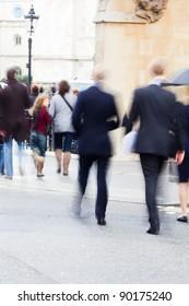 businessmen crossing the street in London