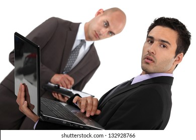 Businessmen with a diary and laptop