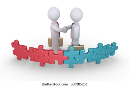 Businessmen of different teams shake hands behind puzzle pieces with different color