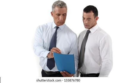 Businessmen discussing a document