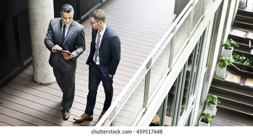 Businessmen Discussion Standing Clipboard Concept