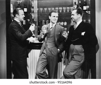 Businessmen drinking together at bar
