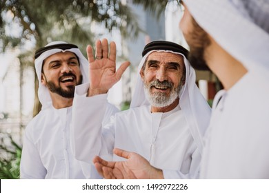 Businessmen in Dubai speaking about business. Local people with traditional clothes