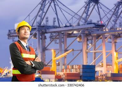 Businessmen engineering standing handsome smile in front of against cargo port looking away