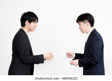 Businessmen to exchange business cards