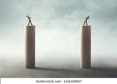 businessmen fight concept; tug of war