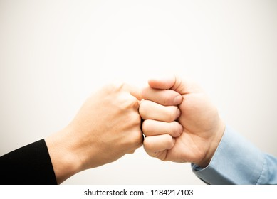 Businessmen fist bump for dealing new project to successful and mission team meeting together congrate.Group of people hands together. Business partnership Concept