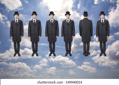 businessmen floating over blue sky with clouds, magritte style