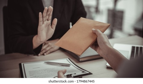 Businessmen give dollars to bribe employees in signing contracts to buy illegal land and real estate, Business fraud and social injustice, Anti Bribery and corruption concept.