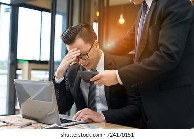 Businessmen with glasses together serious problem fail, tired hard project of daily sale report with laptop computer.