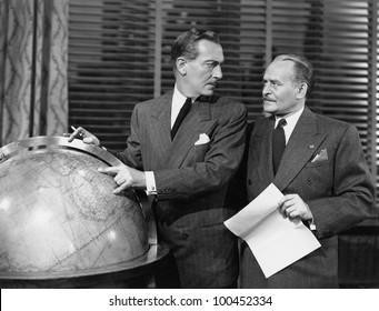 Businessmen with globe