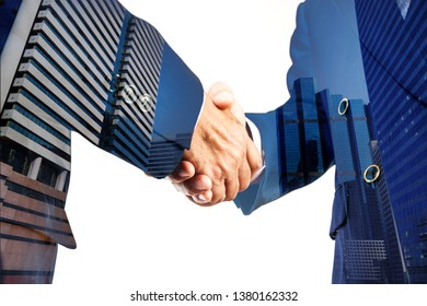 Businessmen hand shake together with Modern City building scene, Double Exposure as Business collaboration or merging Business Concept.