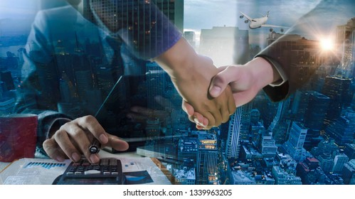 Businessmen hands, the success of logistics and import-export business.