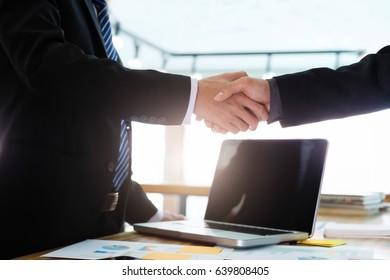 Businessmen handshake. Business partnership meeting concept. Successful businessmen handshaking after good deal.