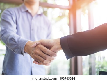 Businessmen handshake and business people ; success, dealing, greeting & business partner concepts - vintage tone,Retro filter effect.