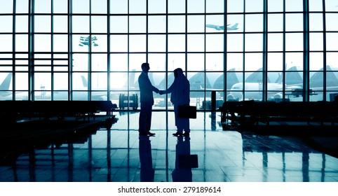 Businessmen Handshake Deal Partnership International Airport Concept