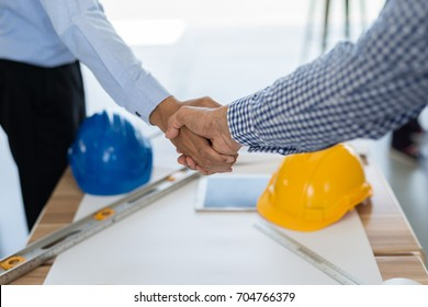 Businessmen handshake for make agreement in contract of Business Construction, Business concept.