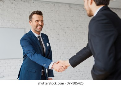 Businessmen handshaking after successful business meeting, negotiation