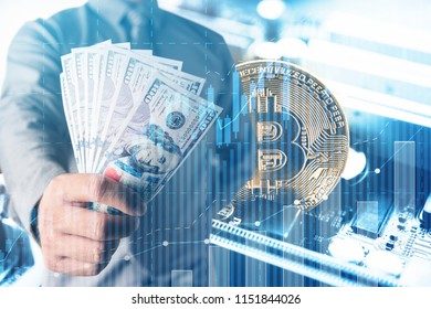 Businessmen hold dollars.Gold Bitcoin with electronic computer processor board.Digital money Digital currency Trading and investment concept.