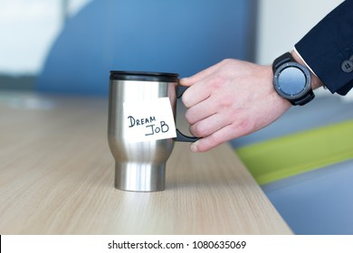 Businessmen holding modern, stylized cup Dream Job. Business and recruitment concept.