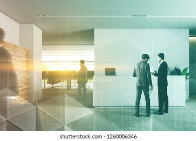 Businessmen in interior of office reception area with white walls, carpet on floor, white reception desk with laptops and wooden lockers. Office in the background. Toned image double exposure blur