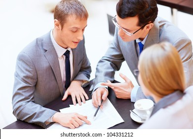 Businessmen with laptop in office