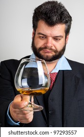 Businessmen looking at a glass of whiskey