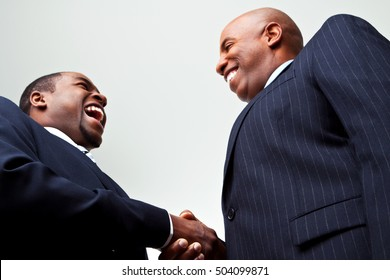 African american greeting stock images royalty free images businessmen making a deal m4hsunfo