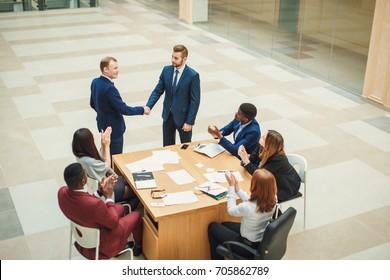 Businessmen making handshake the city - business etiquette, congratulation, merger and acquisition concepts
