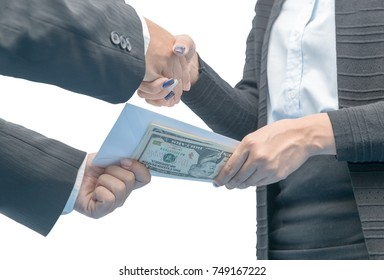 Businessmen making handshake with money under envelope isolated on white background - bribery, corruption and venality concepts