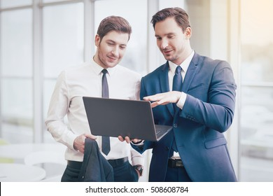 Businessmen making project with a laptop