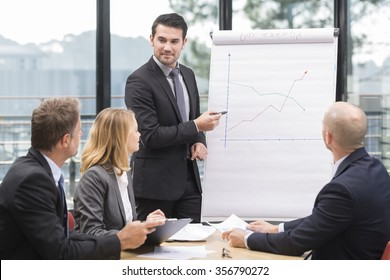 Businessmen are meeting near the flipchart