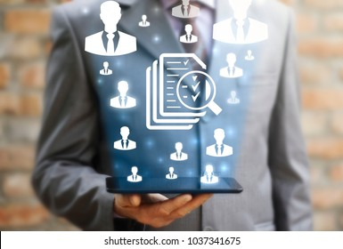 Businessmen offers tablet computer with icon sheet of paper files magnifying glass check mark. Mobile Web Application Find Job. App Curriculum Vitae. Internet Social Network HR, Recruitment.