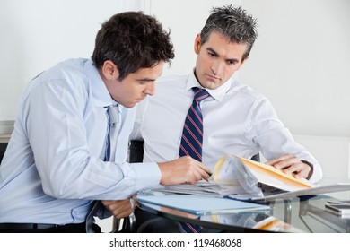 Businessmen with paperwork at a meeting in office