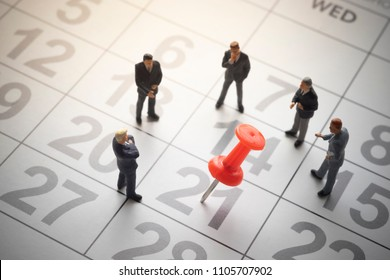 Businessmen with pinned calendar. Business appointment or decision concept