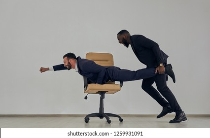 The businessmen playing with chair